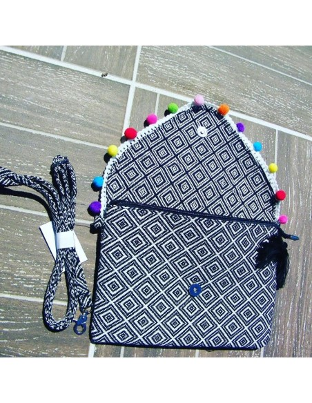 Black boho chic clutch with tassels